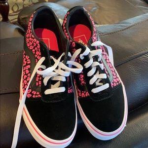 Pink and Black Vans sneakers